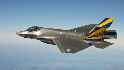 A F-35C conducts a test flight over the Chesapeake Bay on February 11, 2011. Inspections of F-35 engines have been ordered after a runway fire at Eglin Air Force Base on June 23. The F-35 Lightning II has been beset by delays and cost overruns in the years since its introduction.