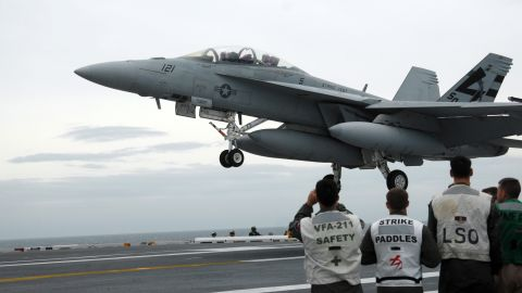An F/A-18 Hornet is pictured aboard the USS George H.W. Bush on May 19, 2009. The F/A-18 Hornet, a late-'70s contemporary of the Air Force's F-16 Fighting Falcon, became the workhorse of U.S. carrier-based air power and still supplements the Navy's and Marines' more current fleet of F/A-18E and F/A-18F Super Hornets. It is designed as both a fighter and an attack aircraft.