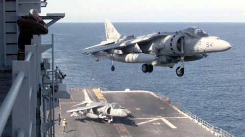 A AV-8B Harrier lands on board the USS Nassau on April 14, 1999, after a strike mission into Kosovo. The AV-8B Harrier is a single-engine ground-attack aircraft capable of vertical or short takeoff and landing. Though production of the aircraft ceased in 2003, the U.S. Marine Corps is looking at systems enhancements and plans to continue using Harriers well into the next decade.