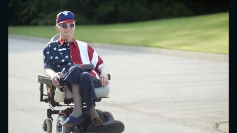 """Walter Lindsay plays Whitney Houston's rendition of """"The Star-Spangled Banner"""" during a golf-cart parade in Tyler, Texas."""