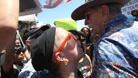 A protester against buses carrying immigrants, right, faces off with a pro-immigration protester in Murrieta, Calfornia, on July 4.