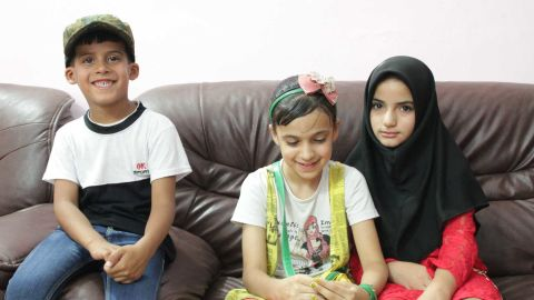 Six-year-old Ali, left, who lost his father in a bomb attack in Sadr City, sits alongside sister Baneen, center, 11, and Baneen's friend Hajer, 11, whose father was assassinated when she was only four years old.