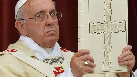 Pope Francis (C) celebrates mass at Saint John's Lateran Basilica in Rome on June 19, 2014, prior to the procession from Saint John's Lateran Basilica to the Basilica of Saint Mary Major to mark the Roman Catholic feast of Corpus Domini commemorating Jesus Christ's last supper and the institution of the eucharist