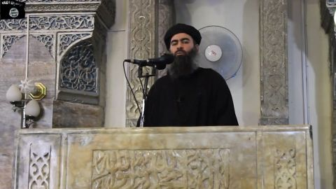 """An image grab taken from a propaganda video released on July 5, 2014 by al-Furqan Media allegedly shows the leader of the Islamic State (IS) jihadist group, Abu Bakr al-Baghdadi, aka Caliph Ibrahim, adressing Muslim worshippers at a mosque in the militant-held northern Iraqi city of Mosul. Baghdadi, who on June 29 proclaimed a """"caliphate"""" straddling Syria and Iraq, purportedly ordered all Muslims to obey him in the video released on social media."""