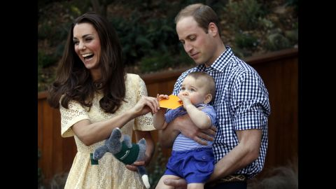 Catherine and William react as their son bites a small present at the bilby enclosure of Sydney's Taronga Zoo on April 20. One of the zoo's bilbies was renamed George in honor of the young prince.