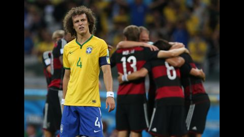 Brazil's David Luiz stands near a group of German players as they celebrate their fifth goal. Germany led 5-0 at halftime.