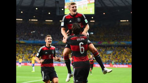 Kroos is lifted in the air by teammate Sami Khedira after he scored to put Germany up 3-0.