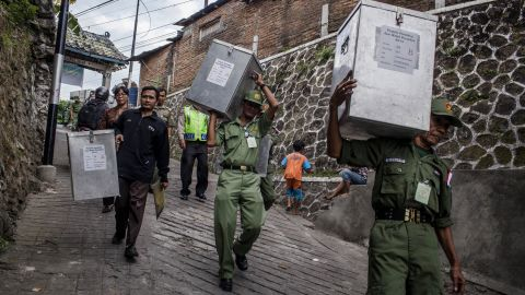 YOGYAKARTA, INDONESIA - JULY 08: Election officers carry ballot boxes from for distribution to the polling stations during preparations for the presidential election on July 8, 2014 in Yogyakarta, Indonesia. Election day in Indonesia sees locals take to the polls to choose between Joko Widodo and Prabowo Subianto as their next president. Recent polls have indicated a tightly fought contest, with allegations of corruption marring the process. (Photo by Ulet Ifansasti/Getty Images)