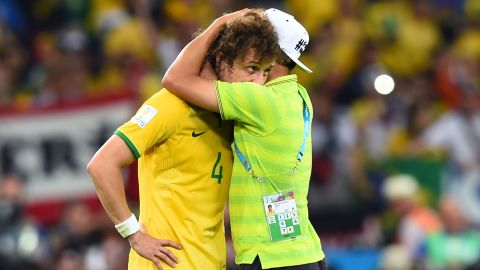 Thiago Silva of Brazil consoles David Luiz after Germany's 7-1 victory during the 2014 FIFA World Cup Brazil Semi Final match between Brazil and Germany at Estadio Mineirao on July 8, 2014 in Belo Horizonte, Brazil. (Photo by Buda Mendes/Getty Images)