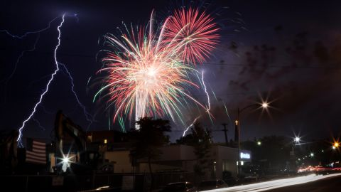 """This lightning storm decided to join in on the fireworks after a 2012 Fourth of July celebration in Wakefield, Massachusetts. """"The rain was right where the storm cell was, so we weren't getting rained on. It was a lucky shot,"""" said <a href=""""http://ireport.cnn.com/docs/DOC-812122"""">Joshua Cruse</a>, who captured this photo."""