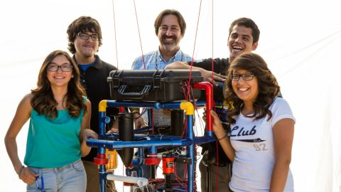 """Teacher Fredi Lajvardi, with, from left, students Diserea Sanders, Sergio Corral , Martin Carranza, and Isela Martinez , and robot nicknamed """"Stinky"""""""