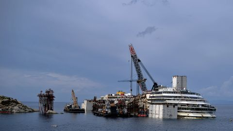 To float the ship, seen here on Thursday, June 26, crews attached 30 steel tanks to fill with compressed air.