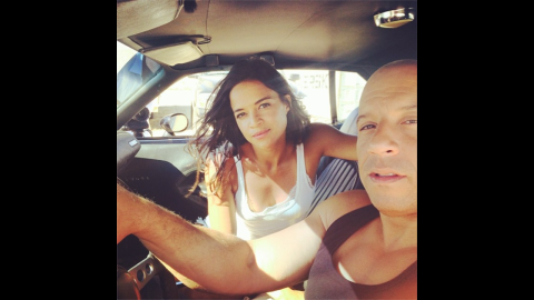 """Actress Michelle Rodriguez posted this photo of her and her """"Fast and Furious"""" co-star Vin Diesel on Thursday, July 10. They just finished shooting the seventh movie in the successful film franchise. """"Ride or Die through thick and thin 15 yrs later surreal to think we made it through such a tough painful production,"""" <a href=""""http://instagram.com/p/qSmofdCZut/"""" target=""""_blank"""" target=""""_blank"""">she wrote</a> on her Instagram account."""