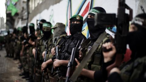 Gunmen from the Ezzedine al-Qassam Brigades, the armed wing of Hamas, line up outside the house of their late leader Ahmed Jaabari, after mourners finished visiting his family to pay their condolences in Gaza City on November 22, 2012. Israeli politicians returned to the campaign trail as the streets of Gaza came back to life after a truce ended eight days of bloodshed, with both sides claiming victory while remaining wary. AFP PHOTO/MARCO LONGARI (Photo credit should read MARCO LONGARI/AFP/Getty Images