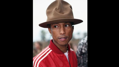 """<strong>Best:</strong> The guiding light for sartorial iconoclasts everywhere, Pharrell Williams proved in 2014 he doesn't give a fig what you think about his fashion. Why should he? He makes pretty much every song you want to dance to. He even made you """"Happy."""" So if he feels like wearing Smokey the Bear's hat, he will. Also? He can wear <a href=""""http://nymag.com/thecut/2014/06/pharrell-continues-his-fashion-reign-of-terror.html"""" target=""""_blank"""" target=""""_blank"""">Uggs to the BET Awards</a> and <a href=""""http://fashionista.com/2014/03/pharrell-williams-tuxedo-shorts-westwood-hat-academy-awards"""" target=""""_blank"""" target=""""_blank"""">short pants to the Oscars.</a> Because he is Pharrell, and you will deal with it."""