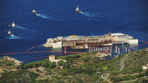 Tugboats pull the Costa Concordia after the first stage of the refloating operation on Wednesday, July 16.