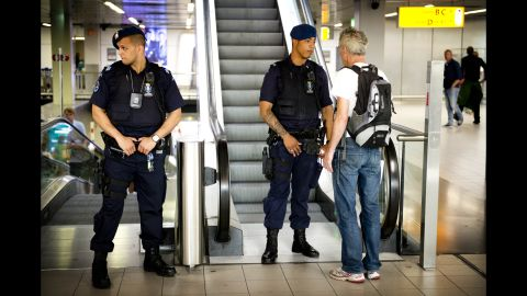 A man talks with security at Schiphol Airport on July 17, 2014.
