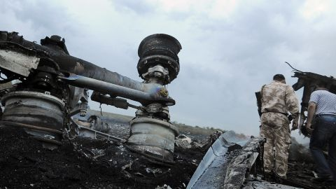 Caption:A man wearing military fatigues stands next to the wreckages of the malaysian airliner carrying 295 people from Amsterdam to Kuala Lumpur after it crashed, near the town of Shaktarsk, in rebel-held east Ukraine, on July 17, 2014. Pro-Russian rebels fighting central Kiev authorities claimed on Thursday that the Malaysian airline that crashed in Ukraine had been shot down by a Ukrainian jet. AFP PHOTO/DOMINIQUE FAGET (Photo credit should read DOMINIQUE FAGET/AFP/Getty Images)
