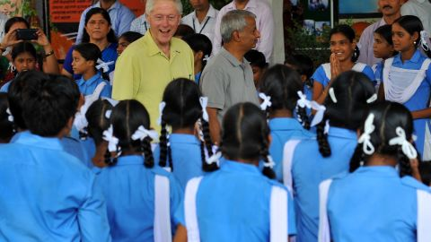 Former US president Bill Clinton smiles as he speaks with Indian schoolchildren during a visit in Sanganer on July 16.