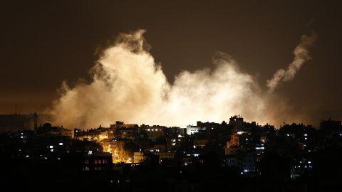 Flare smoke rises into the Gaza City sky on Thursday, July 17.