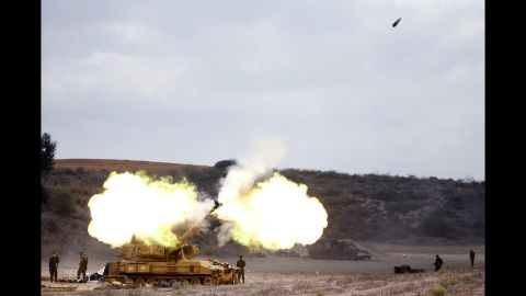 An Israeli tank fires a shell into Gaza on July 18.