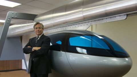 """SkyTran CEO Jerry Sanders with a model pod. """"Being stuck in traffic is just the most stress-inducing, soul-crushing part of society today,"""" says Sanders. """"We really want to make people's lives better and elevated, high-speed transportation is the answer."""""""