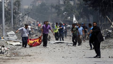Palestinian medics carry a body in Gaza's Shaja'ia district on July 20.