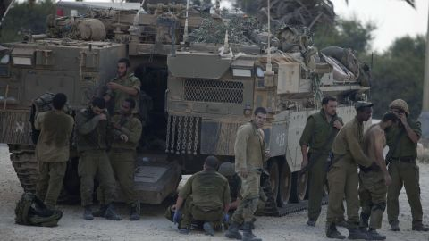 Israeli soldiers give medical care to soldiers who were wounded during an offensive in Gaza on July 20.