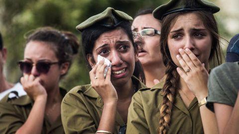Israeli soldiers weep at the grave of Israeli Sgt. Adar Barsano during his funeral Sunday, July 20, in Nahariya, Israel.