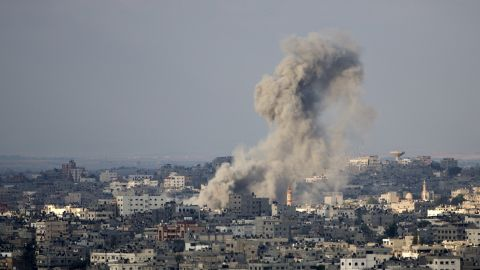 Smoke rises after an Israeli missile strike on Gaza City, on July 19, 2014. Israel's operation against Hamas saw one of its bloodiest days with 46 Palestinians killed in Gaza and two Israeli soldiers dying in a clash with militants who infiltrated he Jewish state.  As Israeli warplanes bombarded Gaza from the air, and ground troops pressed an assault on land, the Palestinian death toll rose to 342, with rights groups warning that a growing number of victims are children. AFP PHOTO / MAHMUD HAMS        (Photo credit should read MAHMUD HAMS/AFP/Getty Images)