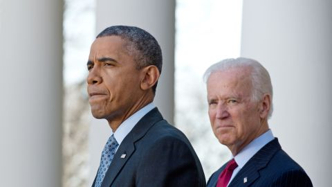 US President Barack Obama speaks about the Affordable Care Act, also known as Obamacare, with Vice President Joe Biden in the Rose Garden at the White House in Washington on April 1, 2014. Hundreds of thousands of Americans rushed to buy Obama's new health insurance plans on March 31, prompting a victory lap from a White House that paid a steep political price for its greatest achievement. The scramble to sign up under Obama's health care law at the end of a six-month enrollment window caused website glitches and long lines at on-the-spot enrollment centers.    AFP PHOTO/Nicholas KAMM        (Photo credit should read NICHOLAS KAMM/AFP/Getty Images)