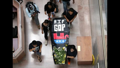 """Activists from the group United We Dream stage a mock funeral service for the Republican Party during a protest in Washington on July 21. They staged the funeral, they said, because """"the GOP has embraced radical right-wing policies and has actively called for the separation of families and the deportation of Dreamers."""""""