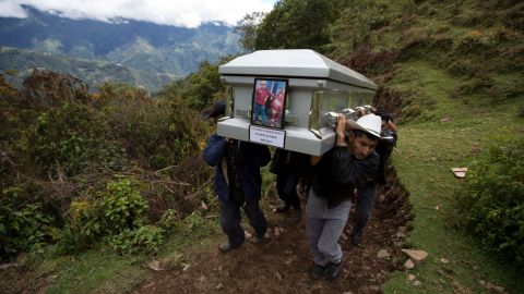 """Relatives carry the coffin of <a href=""""http://www.cnn.com/2014/06/30/us/texas-border-death/"""">Gilberto Francisco Ramos Juarez</a>, an 11-year-old Guatemalan boy whose decomposed body was found in Texas' Rio Grande Valley in June. The undocumented immigrant, who authorities believe may have died from heat stroke, was identified by a phone number on his belt buckle. A series of calls led to Gilberto's father, who described the clothes the boy was wearing."""