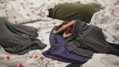 Detainees sleep in a holding cell June 18 at a U.S. Customs and Border Protection processing facility in Brownsville, Texas.
