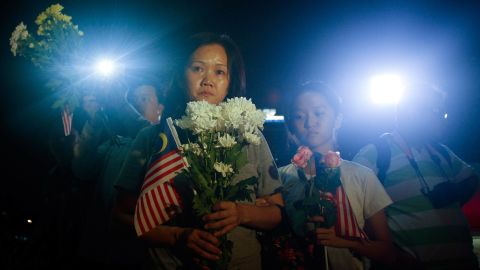 Families of crew members aboard the crashed Malaysia Airlines Flight 17 gather during a vigil in Kuala Lumpur, Malaysia, on Tuesday, July 22.