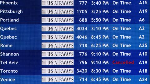A departure board at the Philadelphia International Airport shows that US Airways Flight 796 to Tel Aviv has been canceled, Tuesday, July 22, 2014, in Philadelphia. The Federal Aviation Administration is telling U.S. airlines they are prohibited from flying to the Tel Aviv airport in Israel for 24 hours after a Hamas rocket exploded nearby. (AP Photo/Matt Rourke)