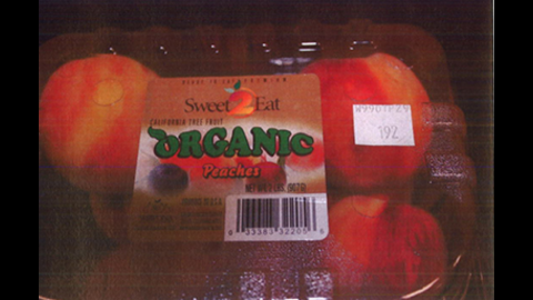 Costco organic peaches in clamshell packaging (2 lbs./8 per carton)