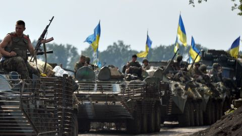 Ukrainian servicemen sitting atop armored personnel carriers (APC) travel near the eastern Ukrainian city of Slavyansk on July 11, 2014. Ukraine's military on Friday reported losing 23 servicemen in clashes across the separatist east that threatened to shatter slim Western hopes of a truce in Europe's deadliest conflict in decades. AFP PHOTO/GENYA SAVILOV (Photo credit should read GENYA SAVILOV/AFP/Getty Images)