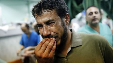 """A Palestinian man cries after bringing a child to the Kamal Adwan hospital in Beit Lahiya on Thursday, July 24. The child was wounded in <a href=""""http://www.cnn.com/2014/07/24/world/meast/mideast-crisis/index.html"""">a strike on a school</a> that was serving as a shelter for families in Gaza. It's unclear who was behind the strike. The Israeli military said it was """"reviewing"""" the incident, telling CNN that a rocket fired from Gaza could have been responsible."""