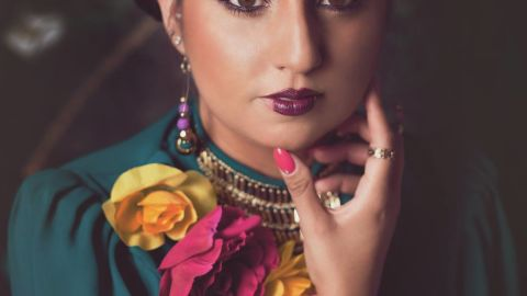 """American photographer <a href=""""https://www.facebook.com/ValerieThompsonPhotography"""" target=""""_blank"""" target=""""_blank"""">Valerie Thompson</a> took this photo of her friend Gloria, an artist heavily influenced by the imagery of Frida Kahlo, using a softer focus."""