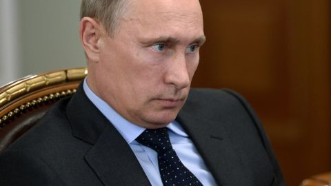 Russia's President Vladimir Putin attends a meeting in his Novo-Ogaryovo residence outside Moscow, on July 24, 2014.