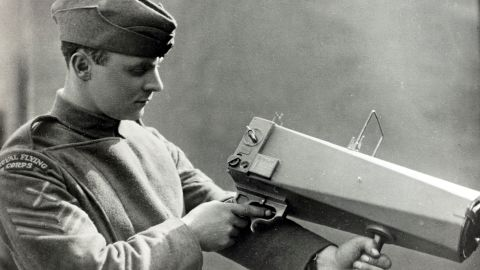 British war photographer David McLellan, originator of the photographic section of the Royal Flying Corps, holds a camera specially adapted for aerial pictures in 1915. The potential of aerial surveillance and bombardment was most rigorously tested and developed in the British campaign against the Ottoman Empire during WWI.