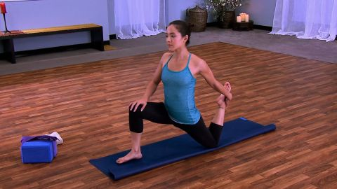 <strong>Low Lunge (Anjanayasana): </strong>To transition from down dog with the hip open to low lunge, rise on the ball of your left foot and bring your right knee in towards your chest, assuming a one-legged plank. Point the toe of your left foot and lift your butt up high as you place your right foot next to the right hand. Have your fingertips under your shoulders and inhale to a flat back. Place your left knee down on the mat. Bring your torso back over your pelvis, with hands on your front knee, and hold the stretch. For more sensation, reach back with your left hand and grab your left foot, pulling the heel towards the left glute.