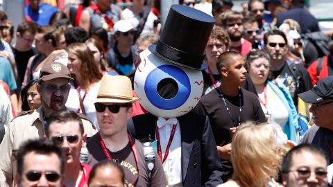 Costumed fans attend Comic-Con on July 24.