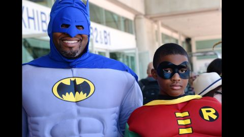 Erien and Adonis Hodge dress as Batman and Robin on July 24.