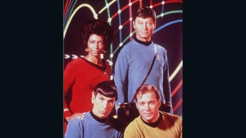 Nichols on set with (clockwise) DeForest Kelley, William Shatner, and Leonard Nimoy.