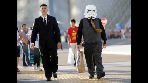 Actor Jack Black, wearing a Star Wars Stormtrooper mask, right, walks outside the convention center on on Thursday, July 24, in San Diego.