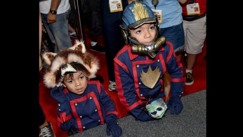 """Two young fans dressed as Rocket Raccoon and Star-Lord from Marvel's """"Guardians of the Galaxy"""" attend the convention."""