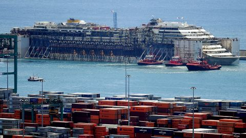 The refloated wreck of the Costa Concordia is towed to the Italian port of Genoa on July 27, ending the ship's final journey to be scrapped two and a half years after it capsized at a cost of 32 lives.