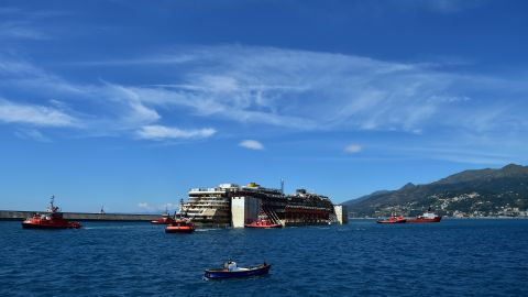 The Concordia is towed into the port of Genoa on July 27.